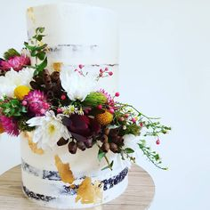 Wedding Cake: Semi-naked 2 tier with fresh native blooms and gold leaf. Gold Leaf, Holi, Frost, Wedding Cakes, Naked, Bloom, Table Decorations, Instagram, Wedding Gown Cakes