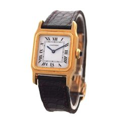 Cartier Lady's Yellow Gold Santos Wristwatch | From a unique collection of vintage wrist watches at http://www.1stdibs.com/jewelry/watches/wrist-watches/