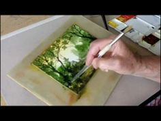 A speeded-up watercolour demonstration showing how I paint a woodland watercolour scene.  Click http://johnsalmonwatercolours.co.uk to see more of my watercolour work from previous years. Watch this video http://www.youtube.com/watch?v=VLiFi31f_88 if you want to get more control with your watercolours. It's about a new tool you make yourself. I ...
