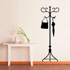 Un perchero de vinilo para la entrada de casa. No ocupa espacio y es perfecto para decorar la pared. =)