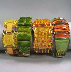 Group of Four Bakelite Bracelets  Each of varying form, comprising two hinged and two link bracelets. Widest 1 3/8 inches.  Sold for 2,200 (Includes Buyer's Premium) Estimate 500-700