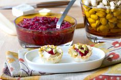 Baked brie that you can hold in your hand! These easy appetizers are savory-sweet with a garnish of cranberry preserves and pistachios. Holiday party snack