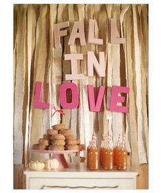 Fall in Love backdrop at an Autumn wedding.  Greet guests with snacks, cocktails, and precious puns. (suggestion only)