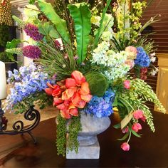 Custom modern floral arrangement made by the designers at Holiday Warehouse