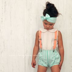 Quinn Puckers for $37.95: -Polycotton  -Pucker front detail  -Green and white striped fabric  -Elastic back & legs   -Belt Loops (Belt sold separately)  -Regular fit  -SUSPENDERS SOLD SEPARATELY  Model is wearing a size 3 and paired with a Gigi blouse and Violet headscarf.