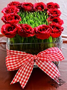 Centerpiece 2 of 3 for Kentucky Derby Theme Party.  Red roses, wheat grass and red gingham ribbon. by The Event Shoppe