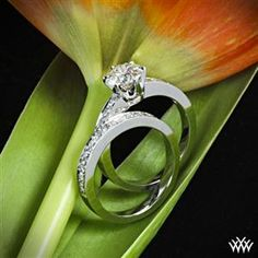 """Captivating and bold, this tiffany style """"Bead-Set"""" Diamond Wedding Set is proof that good things come in twos. The tiffany style """"Bead-Set"""" Diamond Engagement Ring is beautifully crafted and holds 10 magnificent A CUT ABOVE® Hearts and Arrows Diamond Melee (0.30ctw; F/G VS), while the gorgeous matching tiffany style """"Bead-Set"""" Diamond Wedding Ring shines with 12 A CUT ABOVE® Hearts and Arrows Diamond Melee (0.35ctw; F/G VS). The width of both the engagement ring and wedding ring is 2.7mm."""