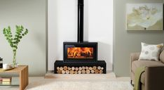 An outstanding range of wood burning stoves & fires from the UK's largest stove and fireplace producer. Wood burning, multi-fuel, Gas and Electric models available. Home, Home Fireplace, Wood Fireplace, Fireplace Design, Freestanding Fireplace, Stove, Lounge Room, Wood Burning, Fireplace