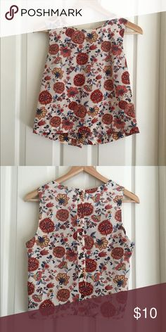 White floral tank top Vintage floral print. Not stretchy material so this will not work well for bustier women :'( very classy and could even be worn to an interview. Button down back. Forever 21 Tops Tank Tops