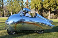 Decopod by Randy Grubb. Side view of the modified scooter, based on the current Piaggio MP3.