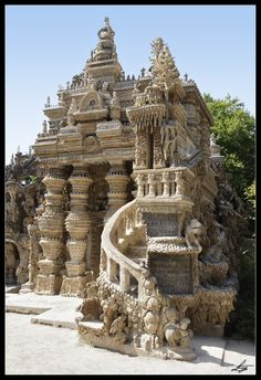 """Le Palais Idéal (the """"Ideal Palace""""), designed and built by Facteur Ferdinand Cheval (1836-1924) He was a French postman who spent thirty-three years of his life building this. Cheval picked up stones during his daily mail round and carried them home to become a part of this. The Palace is regarded as an extraordinary example of naïve art architecture."""