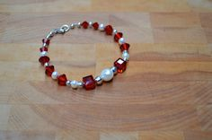 Christmas Bracelet! Sterling Silver, Swarovski Crytals, Freshwater Pearls by ALLtheLOVE on Etsy https://www.etsy.com/listing/210718829/christmas-bracelet-sterling-silver