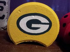 Greenbay Packers painted on cement paver from Roley Poley Painted Pavers on facebook