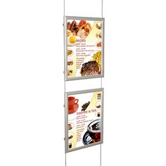 'Snap' frames suspended on wires. Perfect for displaying posters in shop windows, available single or double sided!