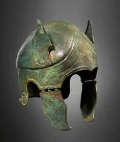 Samno-Attic Bronze Helmet, 4th Century BC  Decorated with unusual bronze wings or ears. Similar helmets have been found in south Italic tombs. This type of helmet was influenced by Attic Greek types. The Samnites were an Italic people living in Samnium in south-central Italy who fought several wars with the Roman Republic.