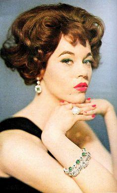 Jane Fonda is wearing faux emerald bracelet and earrings by Trifari, photo by Karen Radkai, 1959