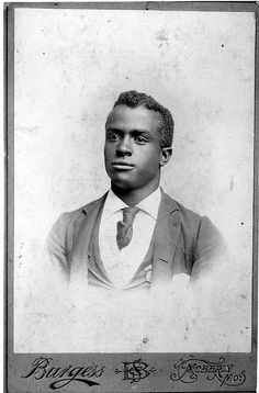 c.1890, Moberly, Missouri --  African American man seated, head and shoulders, in sack suit with tie.