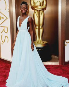 Lupita Nyong'o, in a custom-made Prada gown and Fred Leighton jewels, attends the Oscars held at Hollywood & Highland Center on March 2, 2014 in Hollywood, California. (Photo by Jason Merritt/Getty Images)