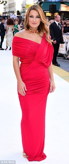 Stunning: The reality star matched her gorgeous dress with a natural lip and a wavy hairdo...