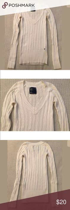 American Eagle White V-Neck Sweater XS Preowned. Worn several times. Minor signs of wear. In good condition. White v-neck sweater  Long sleeves  54% cotton, 26% acrylic, 15% nylon, 5% wool  XS Measured across: Shoulder to shoulder 12in (30.5cm) Armpit to armpit 14in (35.5cm) Waist 11in (28cm) Sleeve length 25in (63.5cm) Length 25in (63.5cm) American Eagle Outfitters Sweaters V-Necks