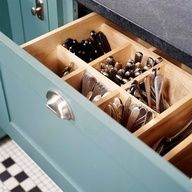 Silverware Storage. Makes more sense then it all lying flat and going everywhere when you open the drawer.