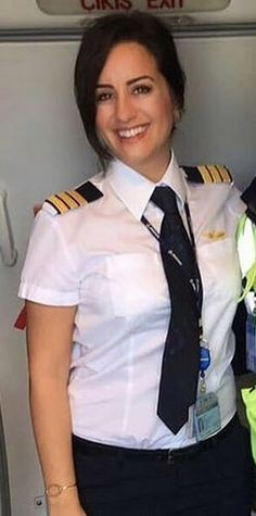 Pilot Dressed In Formal Work Uniform Airline Uniforms, Staff Uniforms, Work Uniforms, Flight Pilot, Pilot Uniform, Female Pilot, Aviators Women, School Uniform Girls, Jet Plane