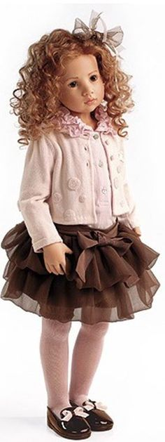 Sapphira by Hildegard Gunzel-pink jacket, chocolate ruffled tu tu skirt, blouse with ruffled collar