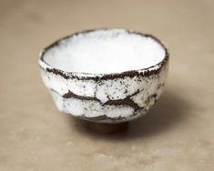 White bowl. Raku inspired ceramics by Laura Allen Müller. Every item is unique and handcrafted in Copenhagen.