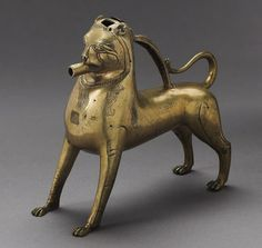 Title Aquamanile (water vessel) in the Form of a Lion Date 13th-14th century Places Creation Place: Europe, Germany Medium Brass Dimensions 24.4 x 10.8 x 27.3 cm (9 5/8 x 4 1/4 x 10 3/4 in.)