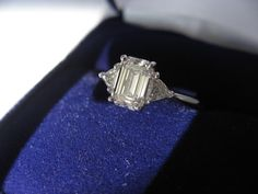 1.02 Emerald Cut with .22 trillion side stones