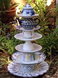 Stacked plates, teacups and teapots to make a tiered server