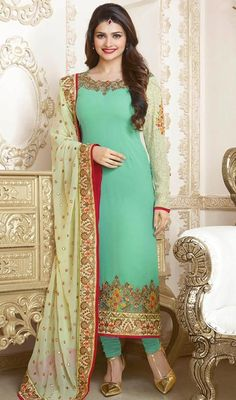 Ramp walk in style like Prachi Desai dressed up in this sea green and cream embroidered georgette churidar suit. This beautiful attire is showing some superb embroidery done with resham work.  #PakistaniDesignEmbroideredSuit
