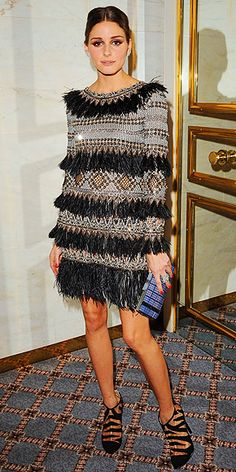 wearing a feathered and beaded party frock (Matthew Williamson) with zebra-striped booties (Topshop) a textured clutch (Charlotte Olympia) and Asprey jewelry.