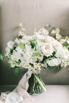 White and blush wedding bouquet with elegant ribbon: http://www.stylemepretty.com/virginia-weddings/2016/08/09/spring-floral-wedding-inspiration/ Photography: Elizabeth Fogarty - http://www.elizabethfogartyphotography.com/