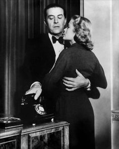 Ray Milland as the plotting husband and Grace Kelly as the wife marked for killing in DIAL M FOR MURDER (1954).