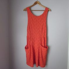 "Free People cutout dress - New without tags!! New -- never worn or washed!!  Armpit to armpit measures 15"". Length 34"" shoulder down. 56 nylon 40% cotton 4% spandex. Such a price fun summer piece! Had some stretchiness to it. Big open and functional apron-style pockets on front.  Bundle for best deals! Hundreds of items available for discounted bundles! You can get lots of items for a low price and one shipping fee!  Follow on IG: @the.junk.drawer Free People Dresses"