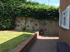 Butterflies, lady birds & bird house