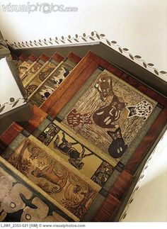 , looks like a hooked rug runner down the stairway - Stock Photos : Masterfile
