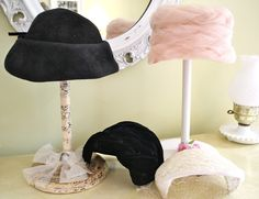 hat display could use candle holders of varying sizes and vintage hats