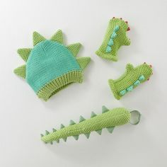 If you see a colorful dinosaur roaming around the playroom, don't be alarmed. It's probably just someone wearing one of our exclusive knit dress-up dinosaur costume sets featuring a cap, mittens and tail. If you see a scaly, giant dinosaur roaming the playroom, chances are it's real.