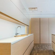 Iced Oak veneer and white Corian in Kitzen's Turku showroom. Corian, Alcove, Showroom, Kitchens, Bathtub, Touch, Inspired, Bathroom, Home