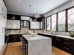 A fog is rolling in.. Moorland Fog that is! Avenue Design Interiors brilliantly used Moorland Fog for the waterfall-edge island and backsplash while Pure White tops the perimeter.