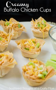 Creamy Buffalo Chicken Cups.  Perfect for parties or anyone who is a fan of bite-size/finger foods!
