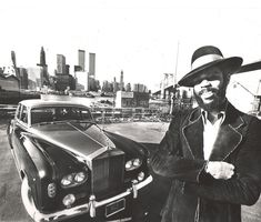 """Fix your peepers on this classic photo of '70s Knicks legend Walt """"Clyde"""" Frazier, above, decked out in front of his classic black and silver Rolls Royce. Description from harryallen.info. I searched for this on bing.com/images"""