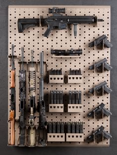 "This package uses 2 of our WP-24.36 wall panels and holds 1 rifle horizontal, 4 rifles vertical, 5 handguns, misc. magazine storage and an accessory self. Total wall space required to fit this rack is about 48"" high x 36"" wide. www.gssdoors.com"