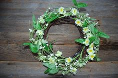 Artificial Spring wreath with greenery and yellow and white flowers.  Willow base. 30cm diameter.