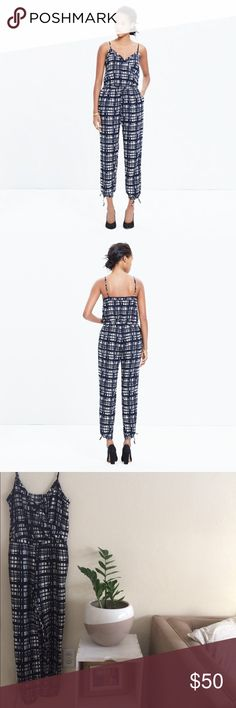 """Madewell faux-wrap cami jumpsuit in Brushstroke Like new condition. Worn only twice. Designed to take the guesswork out of your night-out gear, this plaid one-piece has a strappy cami top, flattering drawstring waist and adjustable ankle ties (in other words, this is a jumpsuit gone sexy).  True to size. Easy, relaxed fit. Front rise: 11 1/8"""". Inseam: 26"""". Leg opening for size XS: 11 1/2"""" when tied. Poly. Machine wash. Import. Item E4888. Madewell Pants Jumpsuits & Rompers"""