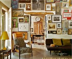 Boho living room, modern mid-century furniture, mixed collection of pictures cover the wall, just beautiful Source: La Maison Boheme