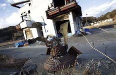 A rusting samurai warrior's helmet rests on broken concrete in in Otsuchi, Iwate Prefecture, an area devastated by the 2011 earthquake and tsunami.
