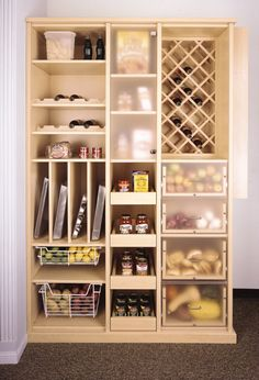 Pantry from Closet World  Likes: frosted doors, frosted fronts of drawers, roll out shelves, storage for baking pans, wire drawers.